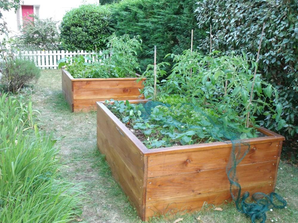 Potager palette bois fabriquer une jardiniere en bois de palette carr potager tage with potager for Jardiniere en bois pour potager